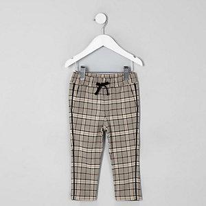 Pantalon fuselé à carreaux écru mini garçon