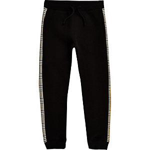 Zwarte joggingbroek met geruite rand voor jongens