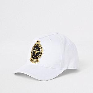 Weiße Kappe mit Bienenstickerei