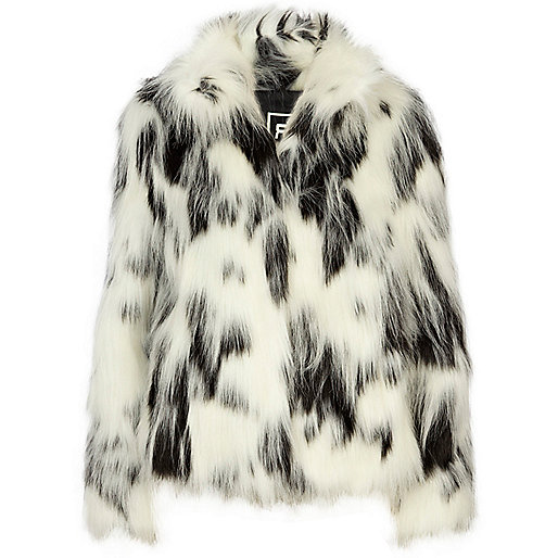 The black part is rabbit fur, and the white/ivory color part is fox fur. There is no size for this jacket, probably fit use Unique Opera Leather Black white Pony Hair Fur coat jacket bolero stroller S