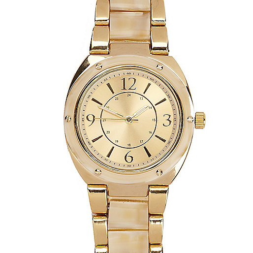 Gold tone round face watch