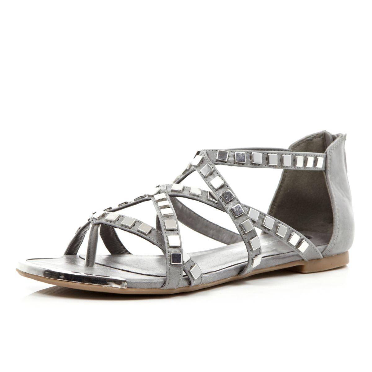 Grey studded metal gladiator sandals
