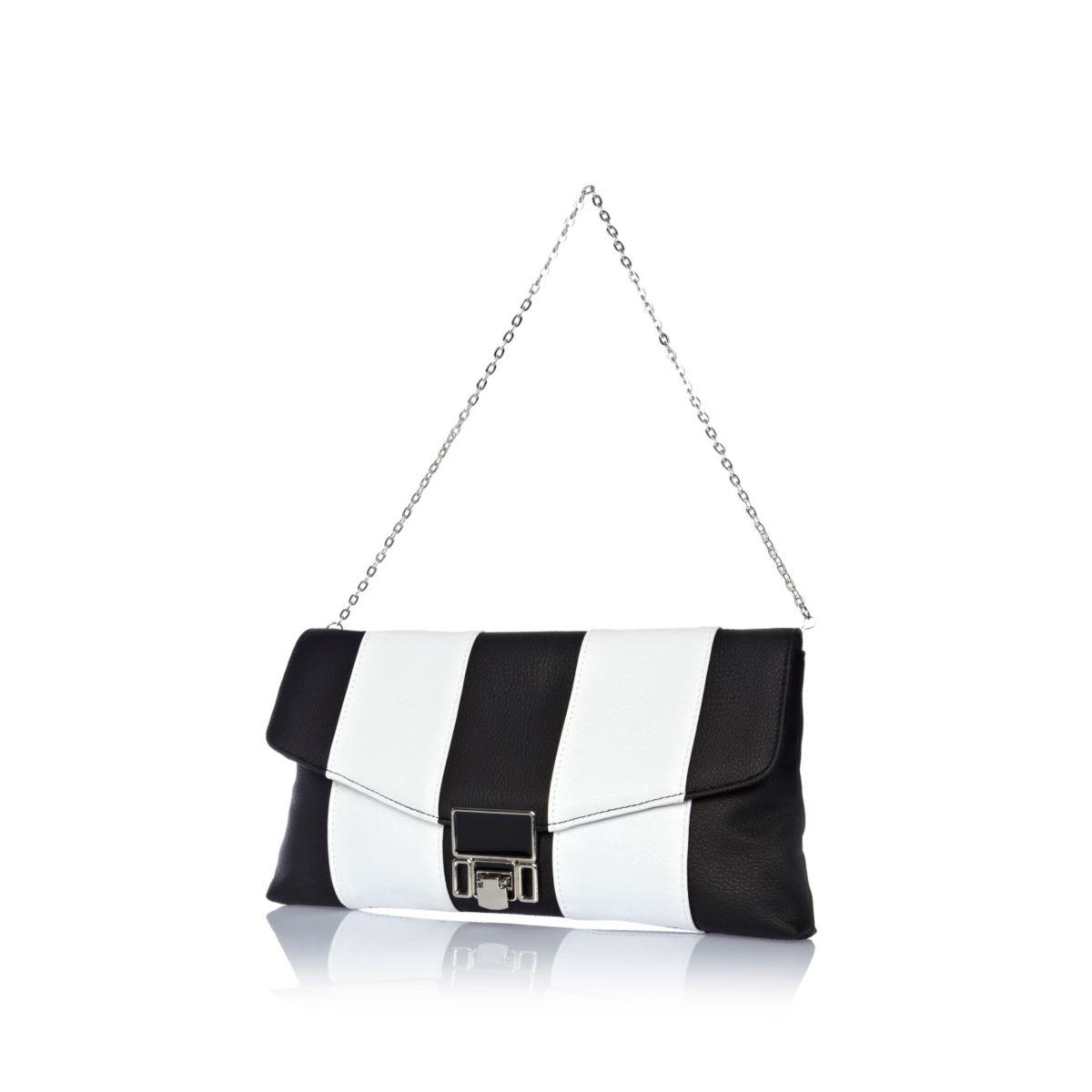Black and white stripe flip lock clutch bag