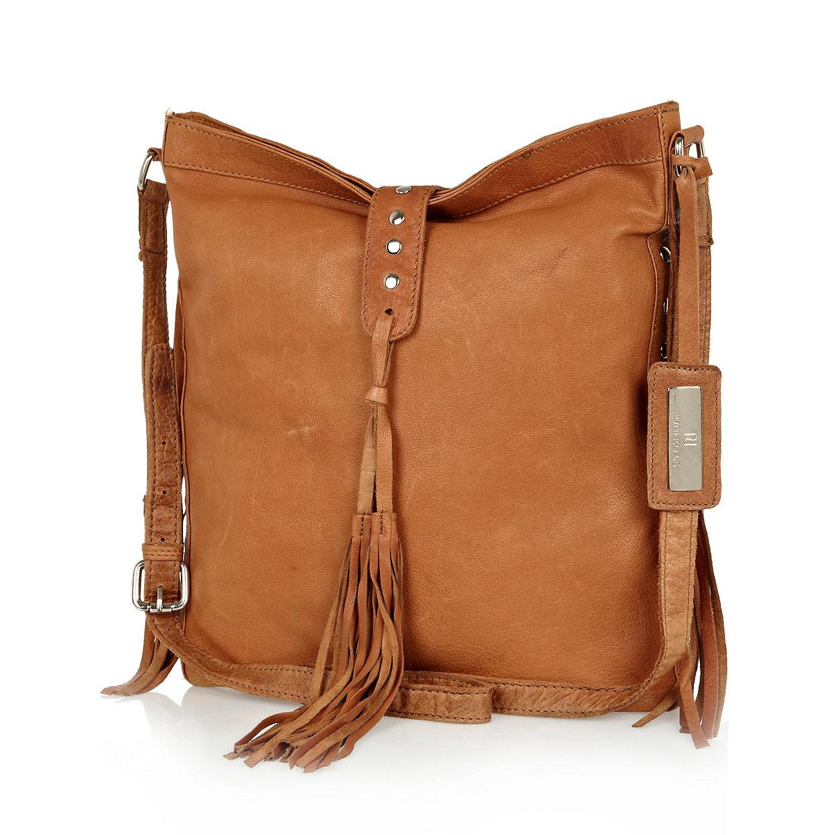 Tan leather tassel messenger bag