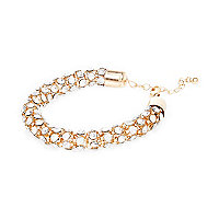 Bracelet en cordelette dorée à incrustations