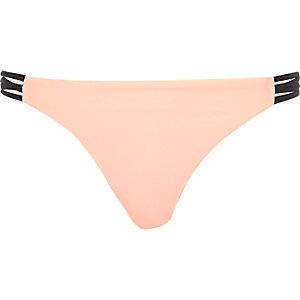 Light pink strappy bikini bottoms