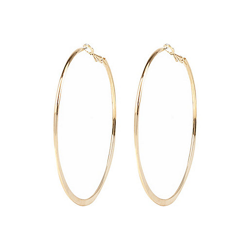 Gold tone medium flat bottom hoop earrings
