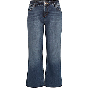 Mid wash cropped raw hem flare jeans