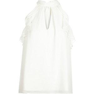 White ruffle sleeveless blouse