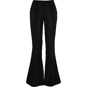Black snake print flare pants