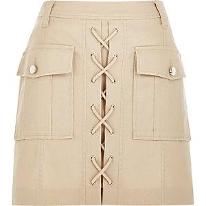 Mini-jupe fonctionnelle chair à lacets