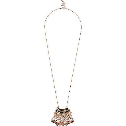 Gold tone dangly long necklace