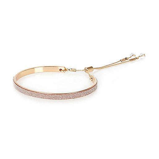 Bracelet doré à paillettes roses style lasso