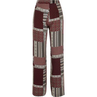 Rode broek met wijde pijpen en patchwork