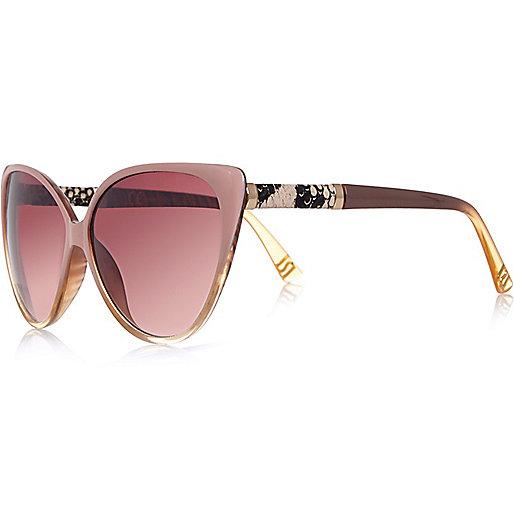 Rosa Sonnenbrille im Katzenaugendesign