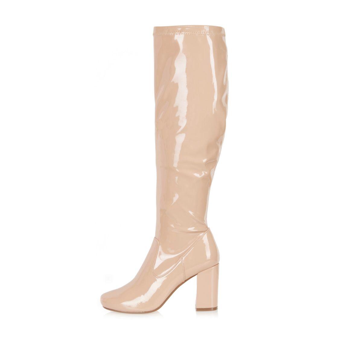 Light pink patent heeled knee high boots
