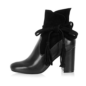 Black suede tassel heeled ankle boots