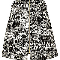 Black animal print zip through mini skirt