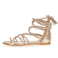 Gold tone gladiator sandals
