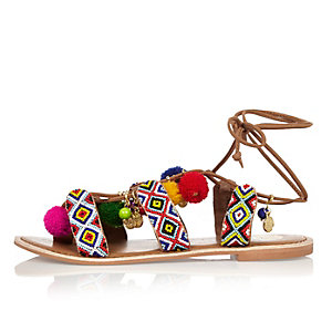 Brown print leather pom pom sandals