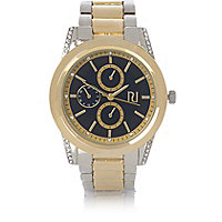 Gold and silver tone coin edge watch
