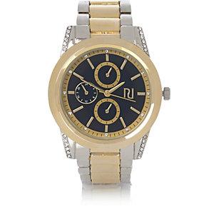 Goud-en-zilverkleurig horloge met gekarteld randje