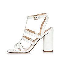Sandales blanches style salomés à talons