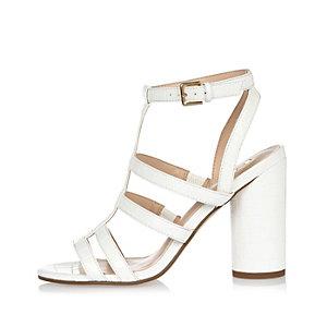White T-bar heel sandals