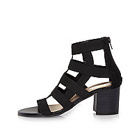 Black caged heel shoe boots