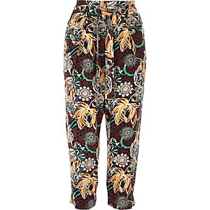 Red print tapered trousers