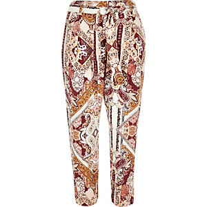Pink paisley print tapered trousers