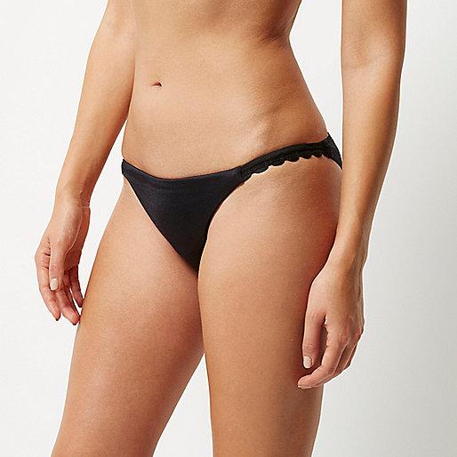 Bas de bikini noir bordé de dentelle