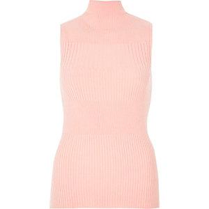 Light pink knit sleeveless turtleneck top