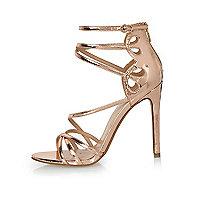 Chaussures doré rose à brides et talons