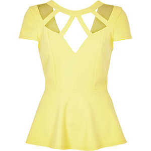 Light yellow caged neck peplum top