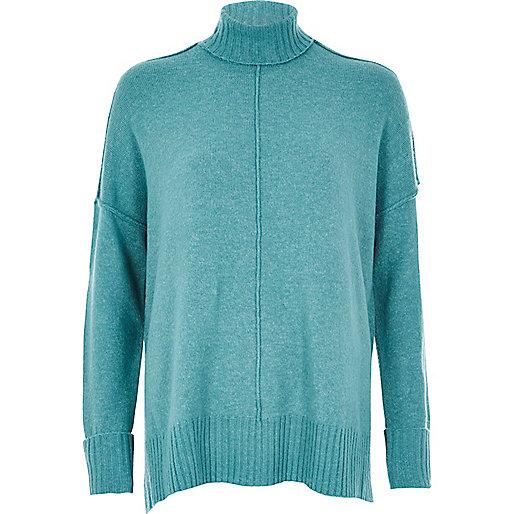 Bright blue turtleneck boxy sweater