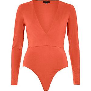 Red plunge bodysuit