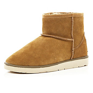 Light brown faux fur lined low ankle boots