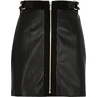 Mini-jupe trapèze noire zippée sur le devant
