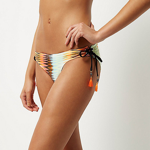 Orange print tassel bikini bottoms