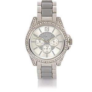 Zilverkleurig groot horloge met ingelegde steentjes
