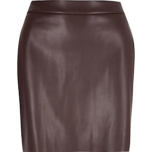 Dark purple leather look mini skirt