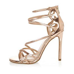 Chaussures doré rose à brides et talons, coupe large