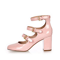 Pink patent thick strappy heeled shoes