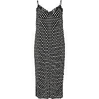 Robe mi-longue à pois noire avec bordure en dentelle et fines bretelles