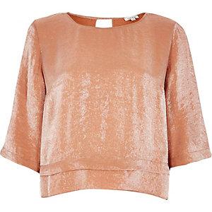Metallic orange layered hem top