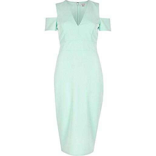 Grünes, ausgeschnittenes Kleid mit Schulterausschnitten