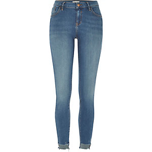 Mid wash Amelie stepped hem superskinny jeans