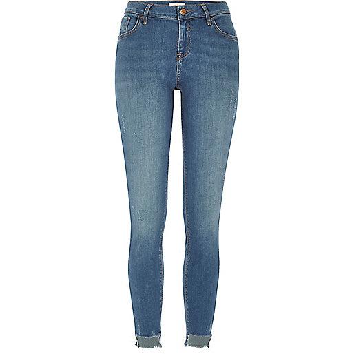 Mid wash Amelie stepped hem superskinny jeans