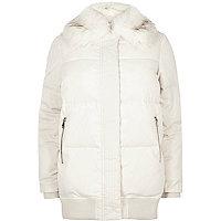 Cream puffer coat with faux fur trim